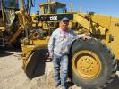 Dale Wilkins, JD Sand Express in Ardmore, Okla., thinks this Cat 120K motorgrader needs to go home with him.