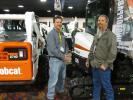 Jason Kelly (L) of Bobcat of the Rockies examines the 3.5-ton (3.1 t) Bobcat E35 excavator with Jimmy Dolan, Douglas County, Colo.