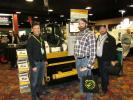 (L-R): Dono Rivas of Roadwidener shows brothers Dave and Rob Pagan of Martin Marietta, Denver, Colo., how this Roadwidener mounted to a S850 Bobcat skid steer works. Bobcat of the Rockies is a distributor of Roadwidener.