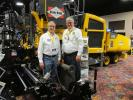 Giles Poulson (L), president of Faris Machinery, Commerce City, Colo., and Mark Pentz, Calvin Group Inc. of Windsor, Colo., discuss the properties of the Volvo P7170 wheel paver.