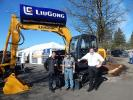 (L-R): Jose Sosa, sales and Josh McCurdy, technician/driver of Pacific Tractor and Equipment, talk with Shane Nugent, LiuGong western regional sales manager about this LiuGong 908B excavator. Jose said this is a great show to meet your customers and to se