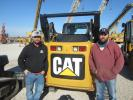 Tyson Wardlow (L) and Beau Shultz, both of Shultz Construction, enjoy the nice weather during the auction.