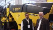 Sergio Solis (L) of Bomag and Bob Joynt, Finkbiner Equipment Co stand in front of the Bomag BM1200-35 milling machine.