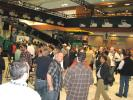 A massive crowd makes its way into the exhibit hall on opening day.