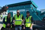 (L-R) are Pasquale Roppo, Liam Quinn and John Jacobs of Bison Iron, the Powerscreen dealer in Alberta, Canada, pictured in front of the Powerscreen Chieftain 2100K.