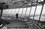 Photo: George Gulacsik/Seattle Public Library. In this photo from early December 1961, a worker is seen on the restaurant level of the Space Needle, with downtown Seattle in the background.