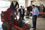Matt McDonald (L), president of Eagle Power & Equipment, invites Congressman Ryan Costello to see Eagle's shop.
