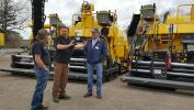 The Bomag Cedarapids pavers are real workhorses, Keith Littler of SEI (C) talks with attendees about the screed options available.
