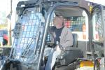 Gil Gorman, sewer foreman of Upper Darby Township, Pa., checks out the controls of a skid steer.