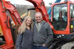 Amanda Merritt of Construction Equipment Guide and Bob Bertholde, owner of B&D Motors in Nelliston, N.Y., with the Kubota mini-excavator he just purchased.