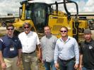 (L-R): Jonathan Holloway of Thompson Machinery talks with Jeff Browning, Ryan Browning, Bo Browning and Michael Howard, the owners of Browning Contractors Inc. of Collierville, Tenn., about this new Cat D6N LGP with grade control, which they plan to purchase.