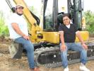 Thompson Machinery customers Louis (L) and Luis Sandoval of Professional Excavator Services/Sandoval Footings, based in Memphis, Tenn., take a brief break before operating another machine of interest.