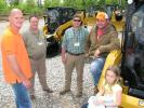 (L-R): Chris Williams, Curb Appeal Tree Service, Hernando, Miss.; Sid Bounds and Michael Miller, Thompson Machinery; and Chris Jones and Ava Williams, also of Curb Appeal Tree Service, get an up-close look at Cat compact track loaders.