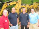 (L-R): Scott Angel, Yancey Rents; Todd Westbrooks and Larry Loveland, Morrow Construction, Stockbridge, Ga.; and Nick Price, Yancey Rents, look over some of the rental units.