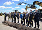 Foley held a ceremonial groundbreaking May 3 on the site of one of the new buildings.