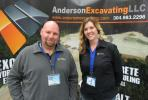 Jason Graham (L) and Brandi Gibson, both of Anderson Excavating, go over the company's full range of construction services conducted within the Tri-State area of West Virginia, Ohio and Pennsylvania.