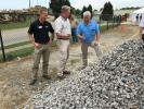 (L-R): Paul Carpenter and John Crocker, both of Carolina CAT, look over the 1 ½ inch minus product with Doc McGee of McGee Brothers in Monroe, N.C.