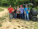 (L-R): Steven Warren, Laci McCauley, Nancy Warren, Jerry Warren and Allen Morris, all of C&J Utility in Burlington, N.C., brought their Benelli and Remington 870 and 1100 12-gauge shot guns.