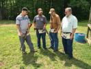 Jesse Carpenter (Second from L) of Carolina Grading and Utility, Ashe County, N.C., shows off his shot gun to (L-R) Travis Walters, Carolina Grading and Utility; Jim Roe and Jim Wyatt both of the town of Wilkesboro, N.C.