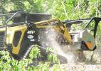 A stout ASV POSI-TRACK RT-120 forestry package model equipped with an FAE RC120 forestry mulcher wows spectators as it grinds through small trees with great ease.
