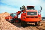The DL450-3 is in the quarry loading the trucks with a 6-cu.-yd. (4.6 cu m) bucket.