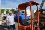 Hugh Bonner of Wolf Equipment, Phoenix, Ariz., inspects the Kubota KH007 mini-excavator.
