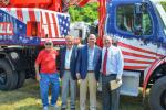 (L TO R) — Ted DeMattio, a Gradall retiree who drove the first Gradall off the New Philadelphia production line; Ray Ferwerda Jr. and Fred Ferwerda, descendants of the inventors of Gradall excavators, whose dealership purchased the 20,000th unit; and Mike Haberman, President of Gradall Industries.