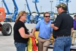 Kevin Shue (R),  Altorfer customer, and his wife talk with Josh