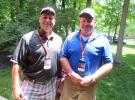 Mike Wilson (L) of Vectren talks with Jim Wilson of Miller Pipeline back at the hospitality house after walking the links