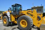 Mike Lalonde of Westrax Machinery climbs aboard the Kawasaki-KCM 95Z7 XT wheel loader.