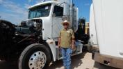 Ron Hail of Roger Properties, Midland, Texas, checks out one of the Freightliner T/A truck tractors.