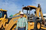 SAECO Inc.'s Lucky Hurford was all smiles as he inspected the lineup of backhoe loaders, including this John Deere 710G. Hurford is based in Tubac, Ariz.