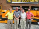 (L-R): Joe Wingerson of Brandt Paving; Walsh Equipment's Mike Walsh and Brad Callihan; Joe Weist of Weist Paving; and LeeBoy's Jeremiah Reinhardt gather for a picture in front of a LeeBoy 1000 paver.