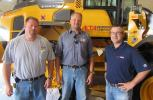(L-R): Rob O'Rourke, Alta branch manager, takes time to thank Ryan Talsma and Dan Leeuw, both of Denney's Excavating, for their recent purchase of a Volvo L90G wheel loader.