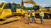 (L-R) are Cody Smith and Camden Guyton, both of Duracap Asphalt Paving Contractors, and Chase Milam, Power Equipment Company.