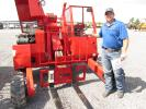 Bubba Paschal of P&P Trailer Sales in Pasadena, Texas, looks over this Manitou cargo mover.