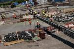 New York Wheel LLC photo. More than 400 trucks from Gilbane Building Company were on the site to pour approximately 4,000 cu. yds. (3,058 cu m) of concrete into the 150-by-30-ft. (45.72 by 9.14 m) foundation.