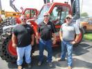 (L-R): Greg Cochran and Brian Fogle, both of PSC Crane & Rigging, speak with Buck Tucker of Franklin Equipment about this Skyjack SJ843 TH telehandler.