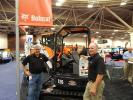 Kevin Usher (L), sales specialist, Tri-State Bobcat, Little Canada, Minn., and Cary Redwig, Bobcat product specialist, West Fargo, N.D., discuss this Bobcat E26 excavator.