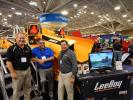 (L-R): Bryce Davis, Leeboy general manager; Doug Thompson, Leeboy Midwest territory manager; and Bryan Hall, Leeboy regional territory manager, stand with a Rosco CSV-816.