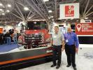 Spencer Nicol (L), Hino Trucks senior manager, and Carlos Fernandez, municipal sales representative, Allstate Peterbilt, St. Paul, Minn., share a laugh and talk about this Hino 2508ALP.