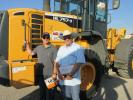 Chad Ray (L) and his father, Steve Ray, of Leasing Systems Inc., Nashville, Tenn., plan to bid on — and win — this Hyundai HL 757-9 loader.