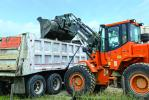 Doosan wheel loaders do a number of different jobs at the same site.
