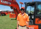 Doug Russell, Kubota service representative, goes over the features of this KX040-4 mini-excavator along with a wide range of other Kubota equipment at the show.