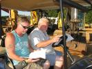 Todd Ellis (L) and Wayne Ellis, both of Northside Equipment Sales, Arab, Ala., take a minute to go over their notes.