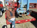 Ed Mal, an independent contractor of Melissa, Texas, takes a rest on this Cat 3306 powered 10x8 pump.
