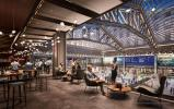 SOM photo. The Moynihan Train Hall will include shops and restaurants located under a new skylight on the building's historic and architecturally dramatic steel trusses.