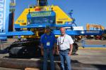 Brian Hall (L) and Randy Hayes of Vacuworx demonstrate their vacuum lifter attached to a Komatsu 360 excavator at the Kirby-Smith exhibit.