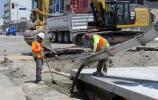 Crews will pour about 170,000 cu. yds. (129,974 cu m) of structural concrete; 5,500 cu. yds. (4,205 cu m) of concrete pavement; and 25,000 tons (22,680 t) of asphalt.