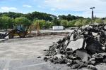 An estimated 5,700 tons (5,171 t) of material will be exported from the site. Phuong Tang, Roxbury Community College photo.